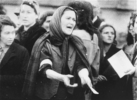 A Jewish woman during a deportation from the Warsaw ghetto. Warsaw, Poland, date uncertain. - Leopold Page Photographic Collection; US Holocaust Memorial Museum
