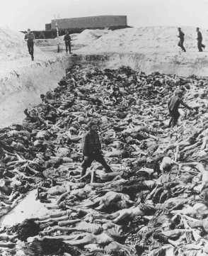 Dr. Fritz Klein, a former camp doctor who conducted medical experiments on prisoners, stands among corpses in a mass grave. Bergen-Belsen, Germany, after April 15, 1945. - US Holocaust Memorial Museum