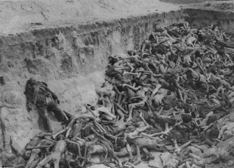 A mass grave soon after camp liberation. Bergen-Belsen, Germany, May 1945. - US Holocaust Memorial Museum