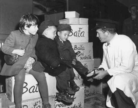 Jewish orphans fleeing Europe are fitted with shoes from the United Nations Relief and Rehabilitation Administration (UNRRA), en route to Allied occupation zones in Germany and Austria. Prague, Czechoslovakia, August 25, 1946. - United Nations Archives and Records
