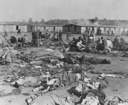 Soon after liberation, camp survivors eat near scattered corpses. Bergen-Belsen, Germany, after April 15, 1945. - US Holocaust Memorial Museum
