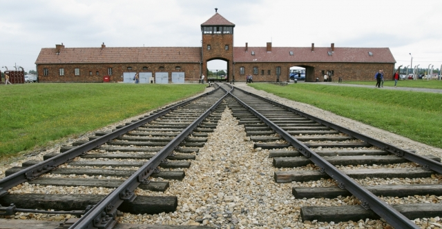 Entrance to the infamous Auschwitz-Birkenau death camp which operated 4 gas chambers where 6,000 people were put to death each day by the Nazi regime. - History.com