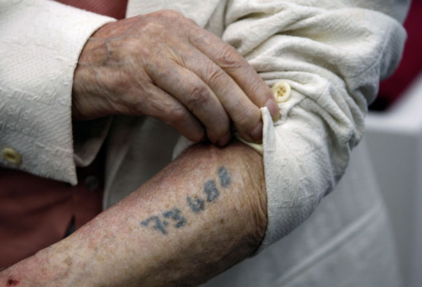 Polish-born Holocaust survivor Meyer Hack shows his prisoner number tattooed on his arm.