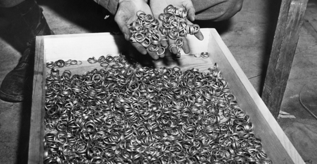 A few of the thousands of wedding rings the Nazis removed from their victims to salvage the gold. U.S. troops found rings, watches, precious stones, eyeglasses, and gold fillings, near the Buchenwald concentration camp. Germany, May 5, 1945. - History.com